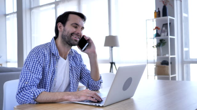 Negotiation, Casual Beard Man Talking on Phone At Work to Discuss Plan ,4k , high quality video