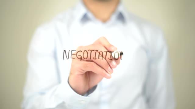 negotiation , man writing on transparent screen - inghilterra sud orientale video stock e b–roll