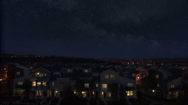neighborhood at night with shooting star. - birlik stok videoları ve detay görüntü çekimi