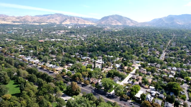 neighborhood streets with mountains - utah video stock e b–roll