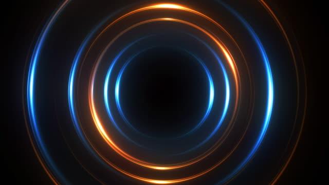 il cerchio al neon illumina lo sfondo astratto per il concetto di vortice colorato. - spirale ricciolo video stock e b–roll
