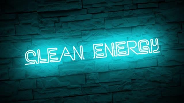 vídeos y material grabado en eventos de stock de un letrero de neón clean energy animado contra una pared de ladrillo limpio. - día de la tierra
