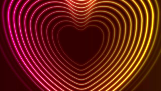 ネオン輝くレーザー心臓形状ビデオ アニメーション - 玉虫色点の映像素材/bロール
