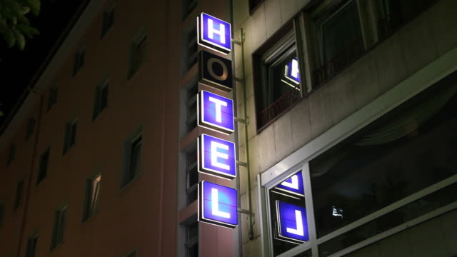 Neon hotel sign, broken letter flickering video