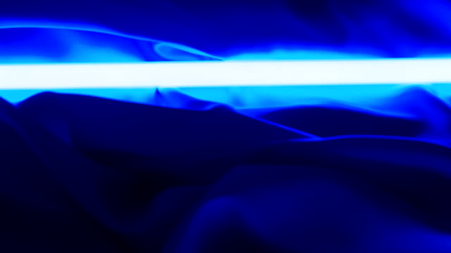 Neon light and textile material. Dark blue background video