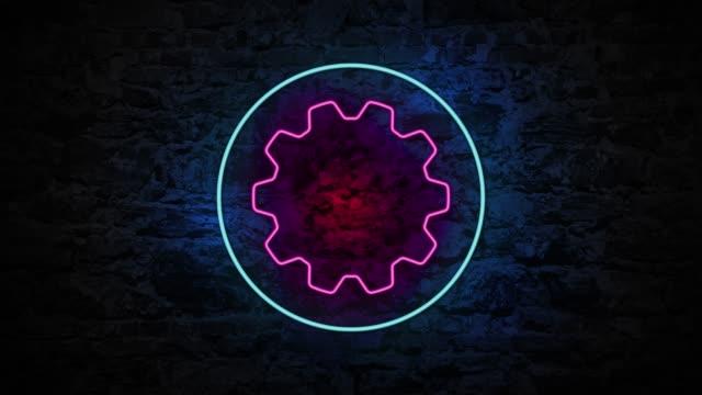 4k neon ljus gear animation på tegelväggen - wheel black background bildbanksvideor och videomaterial från bakom kulisserna