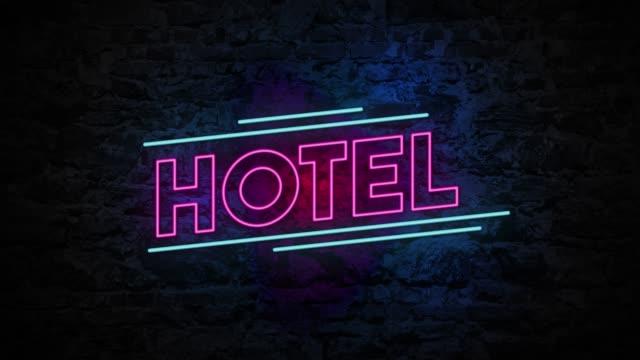 4K Neon light Hotel animation on the brick wall