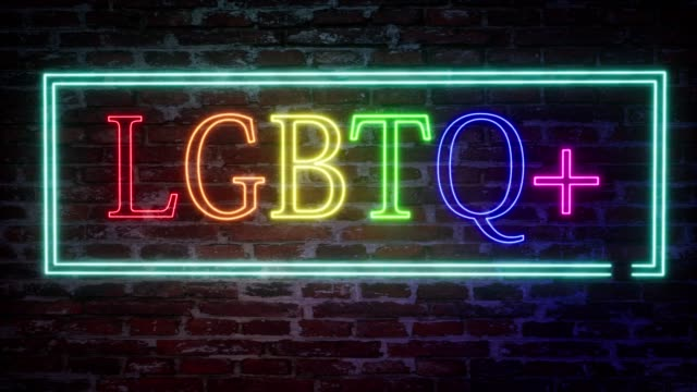 Neon sign with the inscription LGBTQ plus on a brick wall background. Colorful pride design. Quote lettering. Rainbow background. Neon sign with the inscription LGBTQ plus on a brick wall background. Colorful pride design. Quote lettering. Rainbow background. bisexuality stock videos & royalty-free footage
