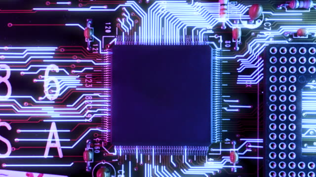 Neon Themed Circuit Board processing Information Concept A futuristic neon coloured motherboard of a computer full of computer chips, wired connections and CPU. Animated digital information and data moving across the motherboard. electrical equipment stock videos & royalty-free footage