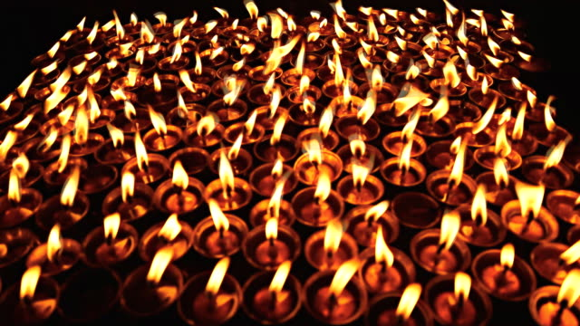 KATHMANDU, NEPAL - APRIL 29, 2015: Nepali residents take part in a candle lighting ceremony for those lost in the earthquake on a street in Kathmandu, Nepal video
