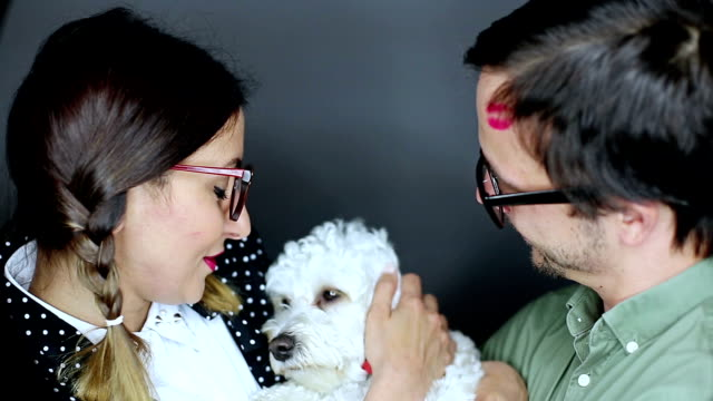 Nerd couple and fluffy white dog video