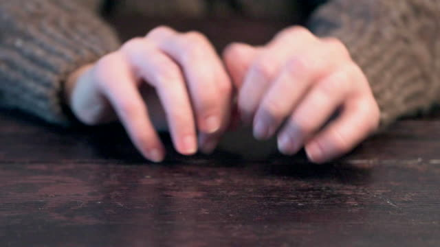 Nervous hands drumming Human hands beating a tattoo on the table. Front view finger stock videos & royalty-free footage