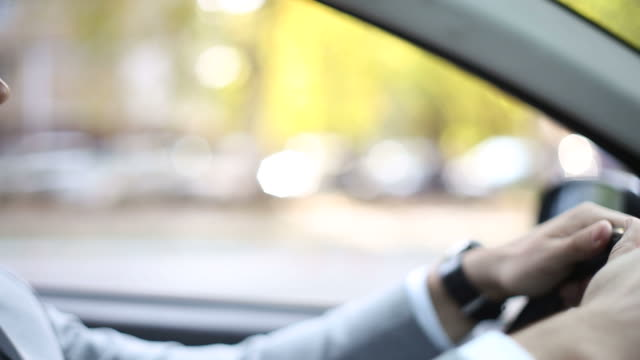 Nervous young businessman in a car honking the horn in traffic Young businessman dressed in suite and white shirt, in a car stacked in traffic jam. He is in hurry and vey nervous because he is not moving. impatient stock videos & royalty-free footage