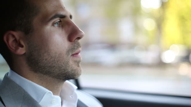 Nervous young businessman in a car