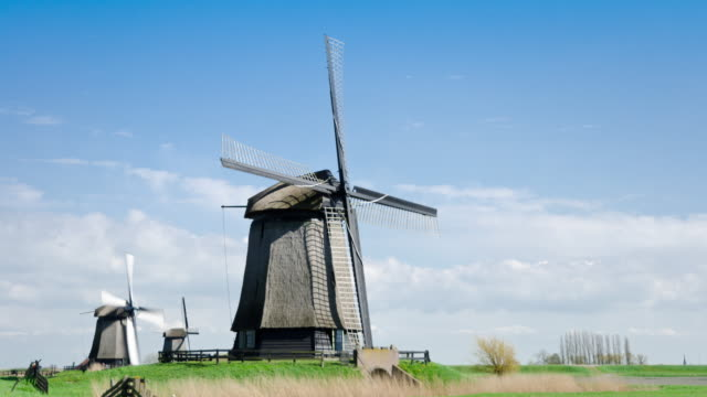 Netherlands landscape with windmills time lapse video