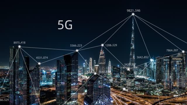 vidéos et rushes de t/l pan 5g network concept, du jour au soir / dubaï, émirats arabes unis - science et technologie