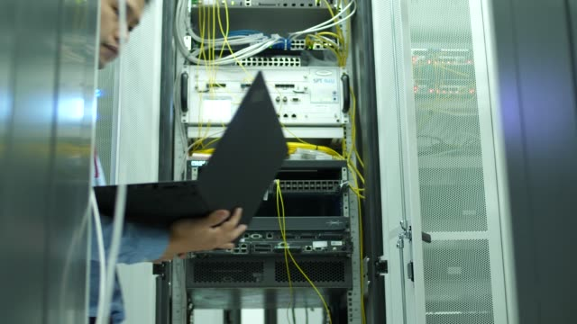 DS:Network Engineer Checking alarm network,data center it professional stock videos & royalty-free footage