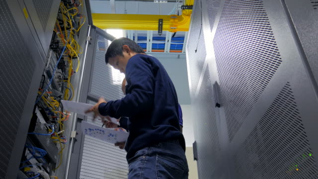 4K:A Network Engineer Checking netwrok equipment video