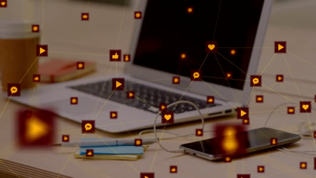 Network of digital icons against laptop