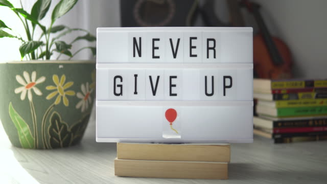 Never Give Up. Decorative Lightbox Never Give Up. Motivational Positive thinking concept. video