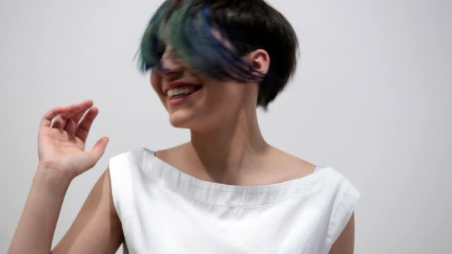 New and fresh hairstyle Close up of a woman with new hairstyle with blue highlights blue hair stock videos & royalty-free footage