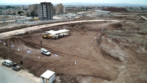 New Apartment Construction in Israel A construction crew begins a new apartment project in Northern Israel. The work site is lined with Israeli flags to mark the property line. 2015 stock videos & royalty-free footage