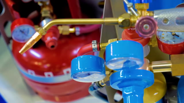 a new autogen with acetylene and oxygen balloon with blue and red manometers - cilindro video stock e b–roll