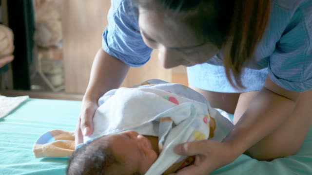 New born baby with his mother video