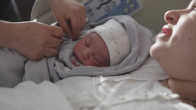 New born baby with his mother New born baby with his mother new life stock videos & royalty-free footage