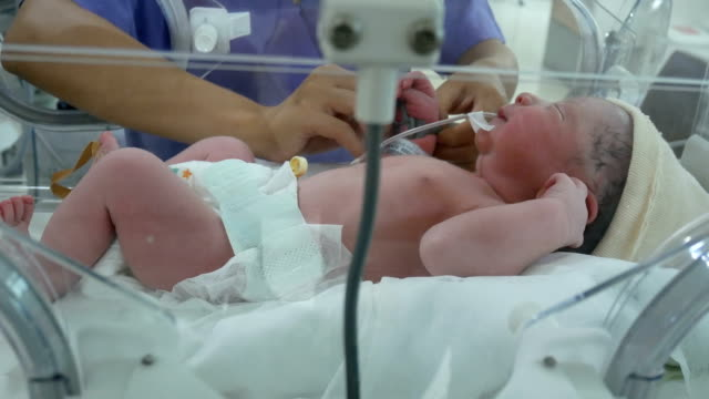 New born measured pulse in nursery after childbirth video