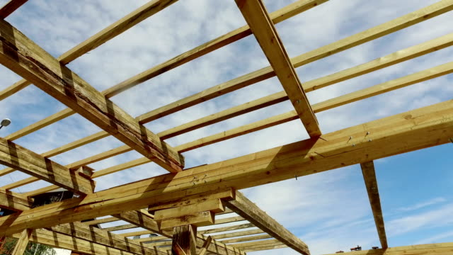 New construction home framing against a blue sky and sun video