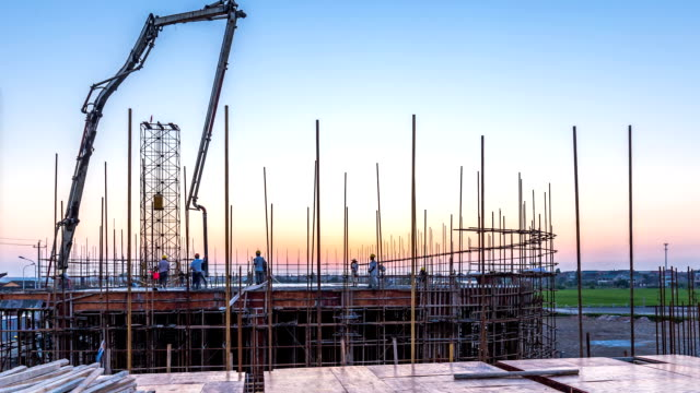 new constructions site in modern city at sunrise.time lapse - spranga video stock e b–roll