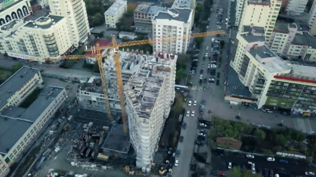 new high-rise buildings constructing in process. video. top view of the construction of an apartment building in the city - burma home do filmów i materiałów b-roll