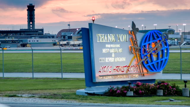 New Orleans Airport Sign Illuminated in Early Evening