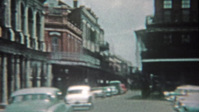 1959: New Orleans bourbon street, jackson square, and stone crypts cemetery mausoleums.