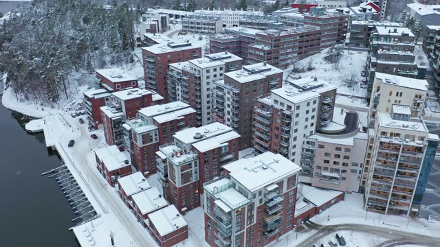 New residential area with apartment buildings in winter Aerial view of modern apartment buildings by the sea in winter in the Nacka municipality outside Stockholm, Sweden. ocean front properties stock videos & royalty-free footage