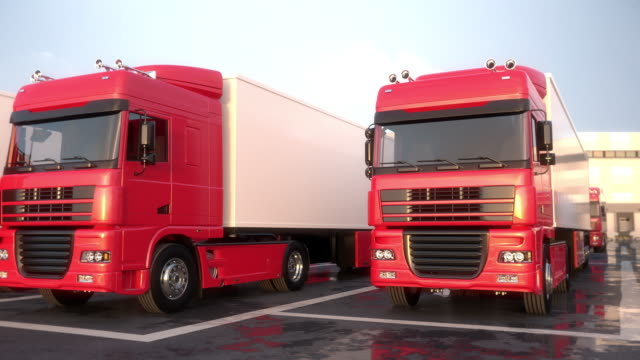 New semi-trailer trucks standing on a car dealer parking lot. Front view. Seamless Loop