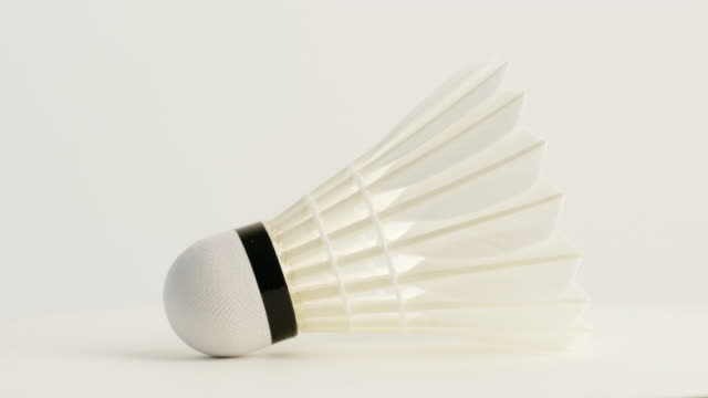 new shuttlecock rotate on white background - badminton stock videos & royalty-free footage