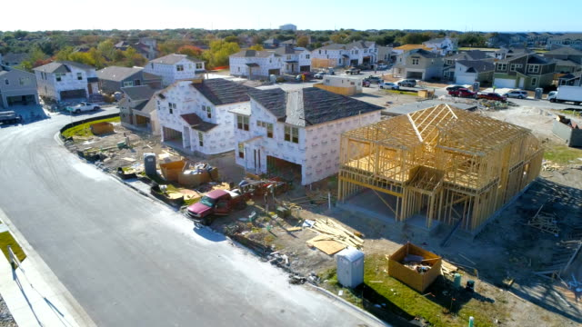 new suburb neighborhood housing development construction of home build - industria edile video stock e b–roll