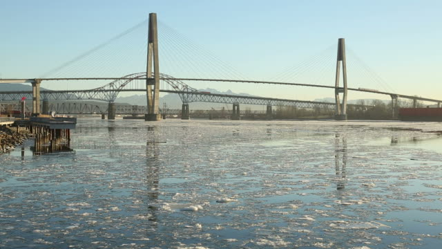 New Westminster Bridges and River Ice The icy Fraser River flows under three bridges at dawn in New Westminster, British Columbia, Canada. fraser river stock videos & royalty-free footage