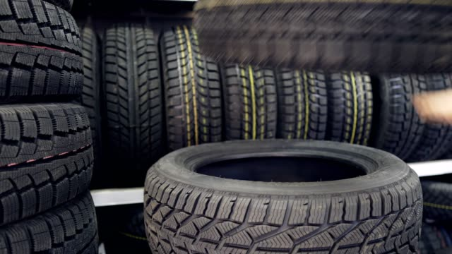 new winter tires stack on top of each other - rotolare video stock e b–roll