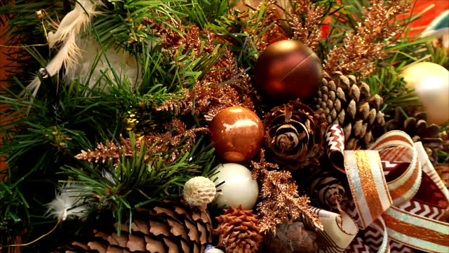New Year and Christmas background. Balls and cones on Christmas tree, blinking bulbs on a garland. video