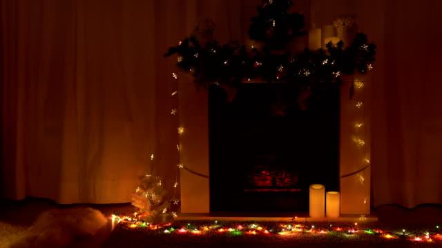new year and christmas celebration near fireplace in room - jodła filmów i materiałów b-roll