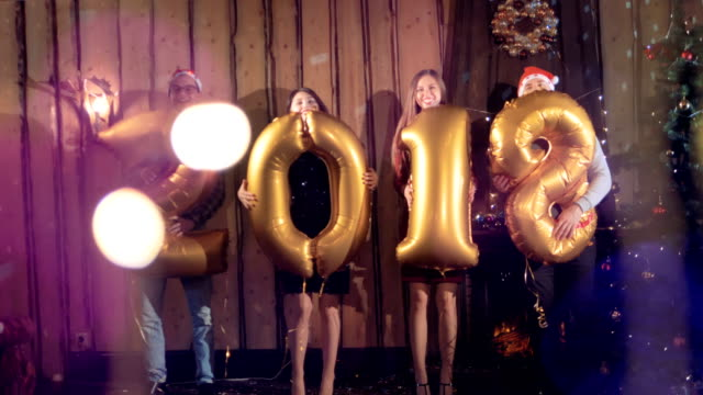 New Year party with revealed 2018 number balloons. video