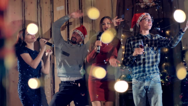 New year partyconcept. Young people having fun at New Year party. 4K. video