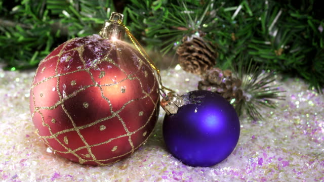 New Year's ball against the background of Christmas tree,Christmas still life video
