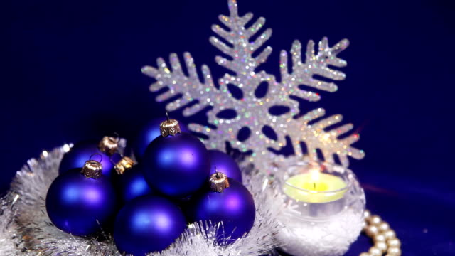 New Year's balls on a dark blue background with snowflake video
