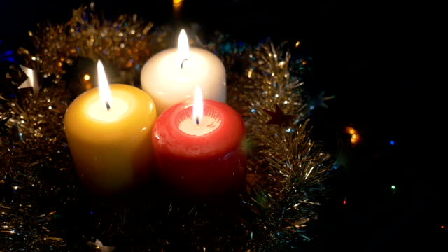 New Year's candles close-up , and Christmas decorations. Blurred background with colored lights. View from the top video