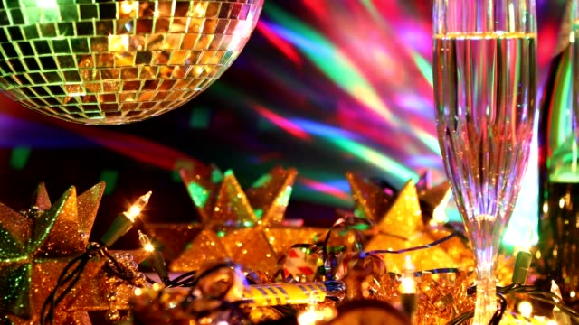 New Year's Eve holiday party with champagne, disco ball, decorations. video