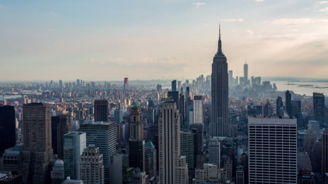new york and empire state building golden hour light day timelapse - new york stock videos & royalty-free footage